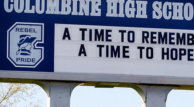 Two Columbine High School students have been hurt when they were attacked by another student with a hammer (AP)