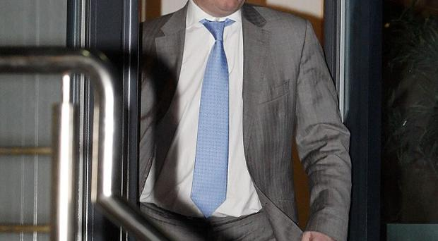 Rangers FC owner Craig Whyte leaves Ibrox Stadium in Glasgow after the club lodged legal papers signalling an intention to enter administration