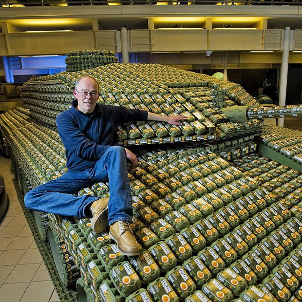 Sculptor Stuart Murdoch with the Challenger II tank he built using Eggs for Soldiers egg boxes
