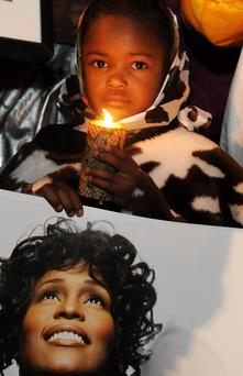 Fans attend attend Whitney Houston Leimert Park Vigil on February 13, 2012 in Los Angeles, California