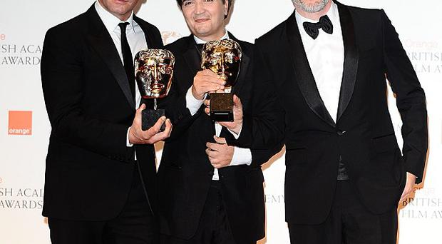 Jean Dujardin, Thomas Langmann and Michel Hazanavicius with their Bafta awards for The Artist