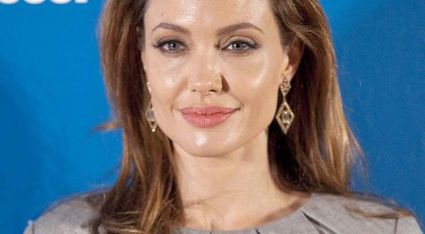 Angelina Jolie plans to attend the first screening of her film in Bosnia (AP Photo/Gero Breloer)