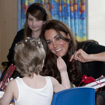 The Duchess talks to children in the Oncology ward during a visit to Alder Hey Hospital