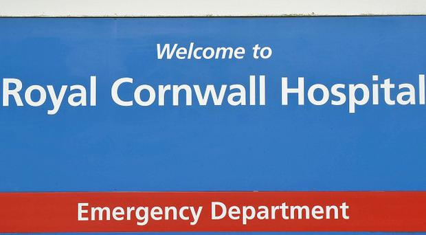 The Royal Cornwall Hospital says 'a couple' of staff have been suspended amid a probe into patient care