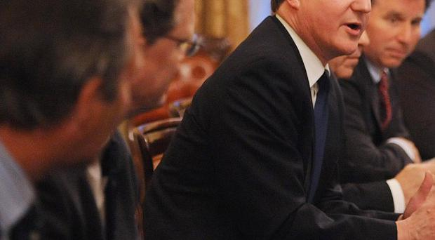 Prime Minister David Cameron hosts a meeting of insurance company bosses at 10 Downing Street
