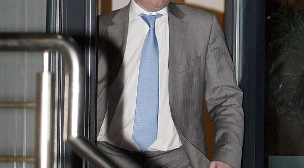 Rangers FC owner Craig Whyte leaves Ibrox Stadium in Glasgow after the club lodged legal papers to enter administration