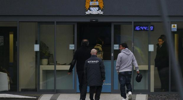 Manchester City's Carlos Tevez (right) arrives at Carrington Training Ground