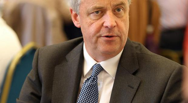 Health Secretary Andrew Lansley was backed by the Prime Minister after calls for him to quit over the reforms
