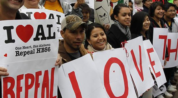 Protesters opposed to the stringent House Bill 56 immigration law outside the Alabama Statehouse in Montgomery (AP)