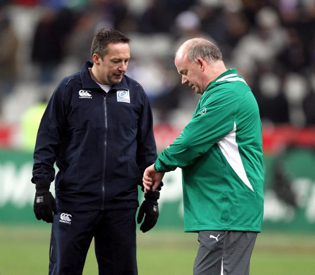 Referee Dave Pearson with Ireland coach Declan Kidney ahead of the announcement on Saturday night that the match was off