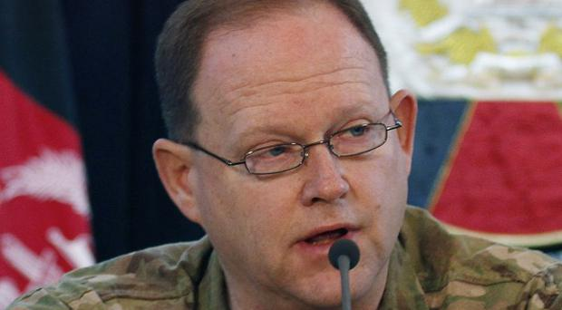 US Brig Gen Lewis Boone, at a press conference in Kabul during which Nato said it regretted killing eight Afghan civilians (AP)