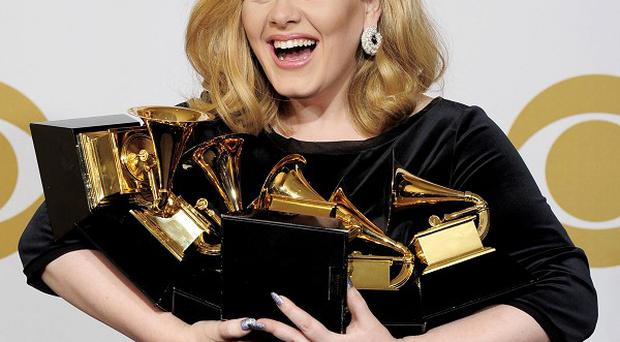 Chart-topping star Adele said she is 'still coming to terms' with her success at the Grammy awards (AP)