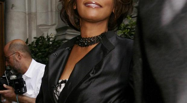 Whitney Houston was found by a member of her entourage in her hotel room