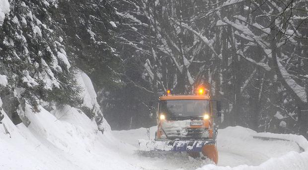 A snowplough clears a road near Harrachov in the Krkonose Mountains 80 miles from Prague (AP)