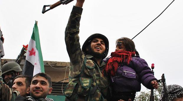 Syrian army defectors who have joined the fight in Homs (AP)