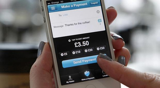 The Barclays Pingit app allows users to send and receive cash to anyone with a UK current account and mobile phone number (VisMedia/PA)