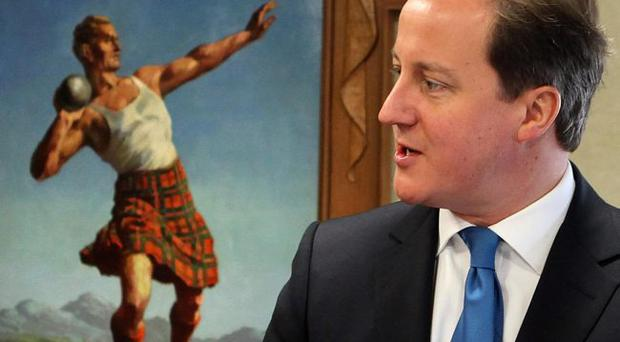 Prime Minister David Cameron during a visit to the Quaker Oats site at Cupar in Scotland. February 16, 2012.