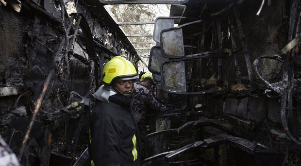 Rescuers in the wreckage of the West Bank bus crash(AP)