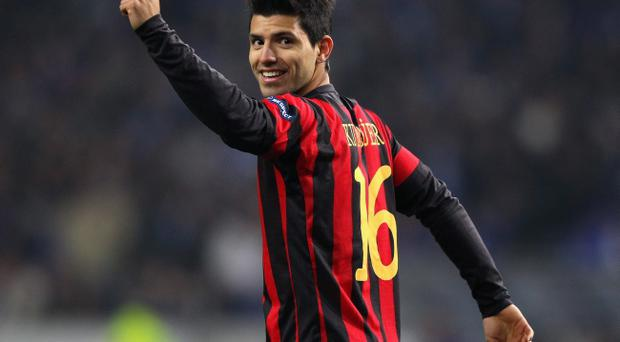 PORTO, PORTUGAL - FEBRUARY 16: Sergio Aguero of Manchester City celebrates after scoring his goal during the UEFA Europa League round of 32 first leg match between FC Porto and Manchester City at Estadio do Dragao on February 16, 2012 in Porto, Portugal. (Photo by Alex Livesey/Getty Images)