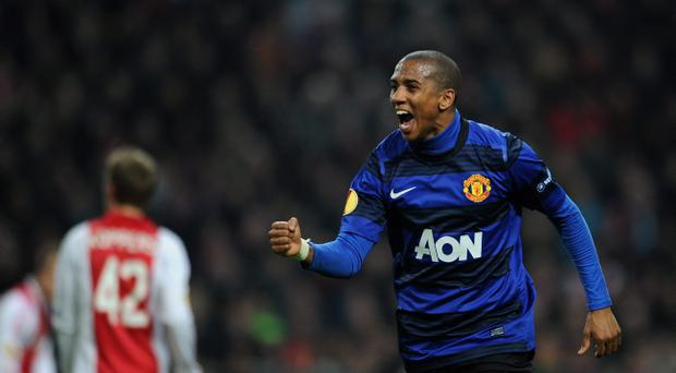 AMSTERDAM, NETHERLANDS - FEBRUARY 16: Ashley Young of Manchester United celebrates scoring his sides opening goal during the UEFA Europa League round of 32 first leg match between Ajax and Manchester United at Amsterdam Arena on February 16, 2012 in Amsterdam, Netherlands. (Photo by Jasper Juinen/Getty Images)