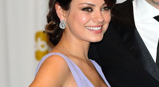 Mila Kunis could be starring as Jackie Kennedy