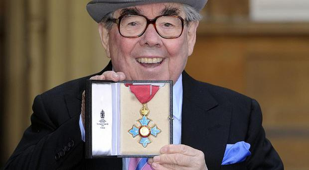 Ronnie Corbett received his CBE from the Queen