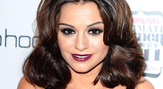 Cher Lloyd said sorry to former mentor Cheryl Cole after joking about her singing
