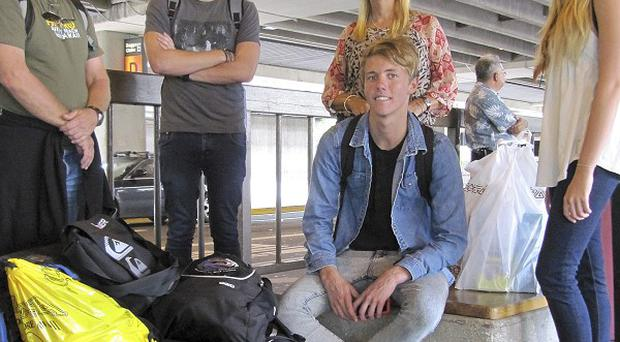 The Maudsley family wait at Honolulu airport after discovering their Air Australia flight wasn't taking off (AP)