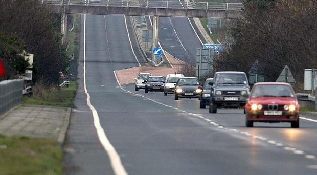A motorist was injured after a concrete block was dropped on to his car from a bridge over the A442 in Shropshire