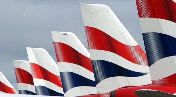 A BA air steward has been charged with communicating a bomb threat