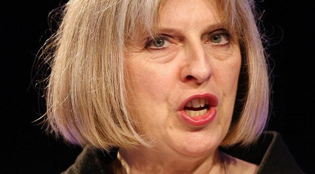Home Secretary Theresa May says the UK and Jordan remain committed to ensuring that Abu Qatada must face justice