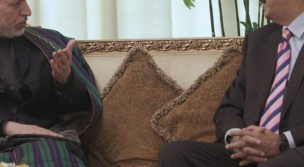Afghan President Hamid Karzai, left, in talks with Pakistan's Prime Minister Yousaf Raza Gilani(AP)