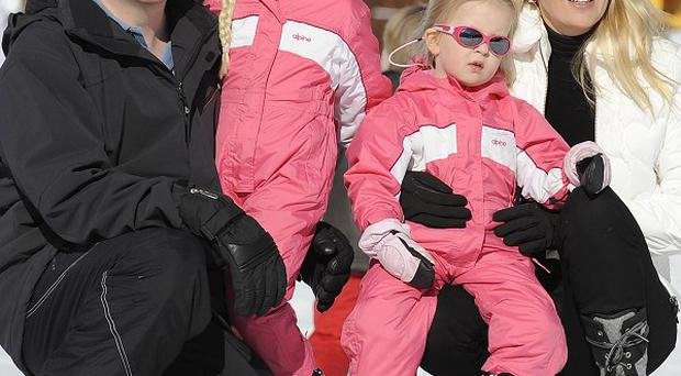 Prince Friso, left, and his wife Princess Mabel, with their daughters Luana and Zaria in the ski resort (AP)