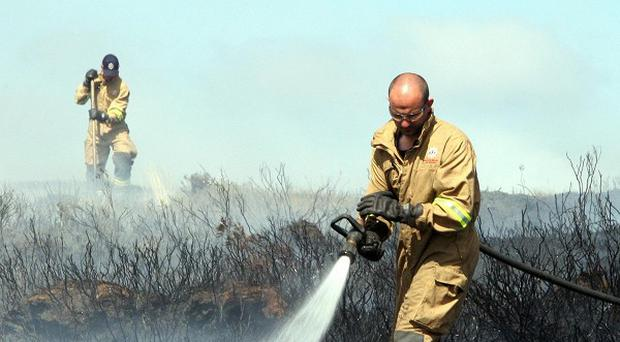 Firefighters try to contain a gorse fire in North Antrim, near Ballypatrick forest