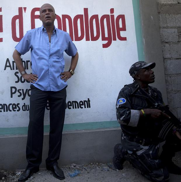 Haiti's president Michel Martelly had rocks thrown at him in the capital (AP)