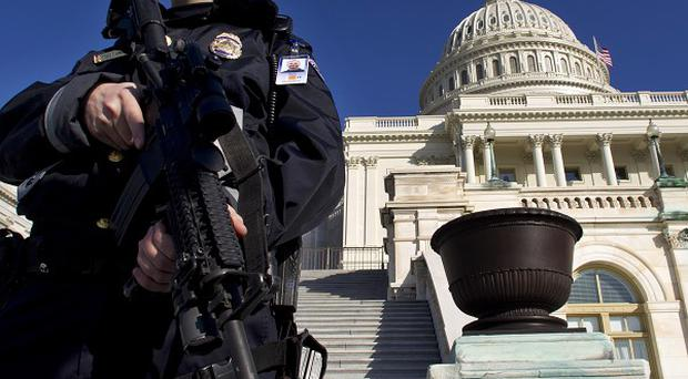 A Moroccan man has been arrested in an FBI sting near the US Capitol while planning to detonate explosives, police say (AP)