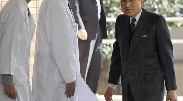 Emperor Akihito arrives at the University of Tokyo Hospital for surgery (AP)