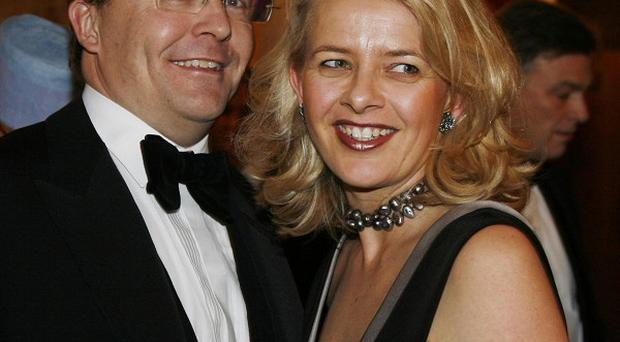 Dutch prince Johan Friso, pictured with his wife Mabel, was hit by an avalanche while skiing in Austria (AP)