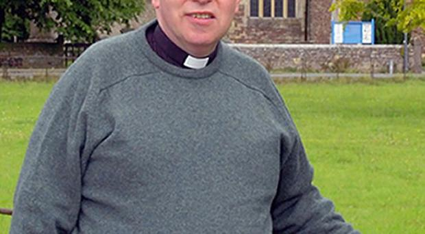 The Rev John Suddards was found stabbed to death at his home on Castle Street in Thornbury, south Gloucestershire, on Tuesday