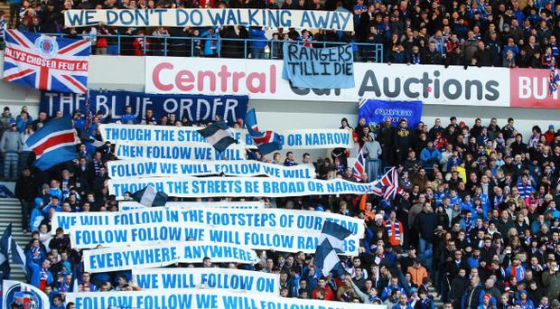 Rangers' fans display banners during the Clydesdale Bank Scottish Premier League match at Ibrox Stadium, Glasgow
