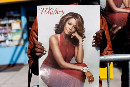 Fans mourn at the funeral service for Whitney Houston