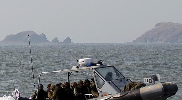 South Korean navy sailors in a speedboat patrol around western Yeonpyong Island after finishing their exercise (AP)