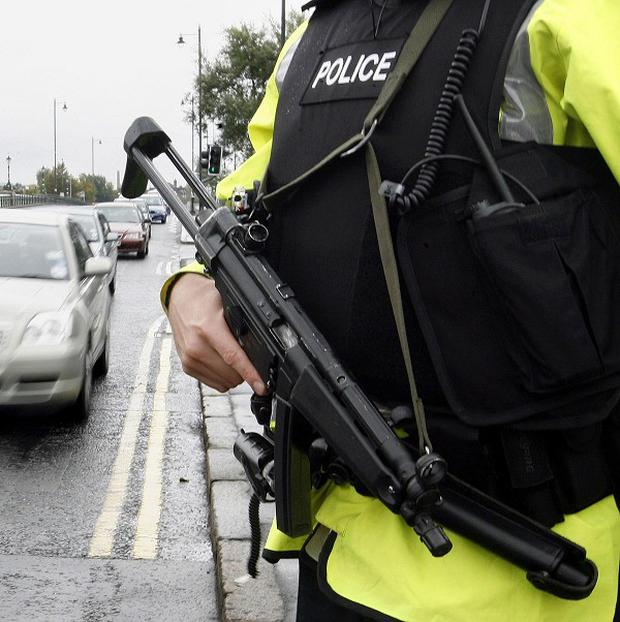 Police are investigating after a man was tied up by raiders in Belfast