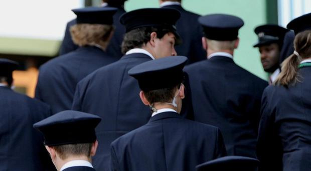 The London Olympics security force will include 2,100 part-time military personnel, the Defence Secretary said