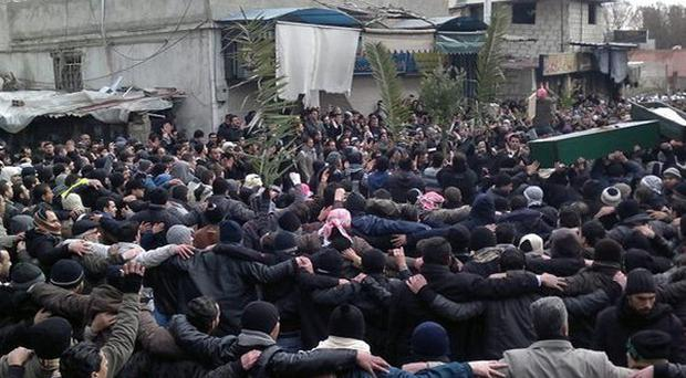 Anti-regime mourners carry the coffins of two protesters they say were killed by Syrian security forces in Damascus (AP)