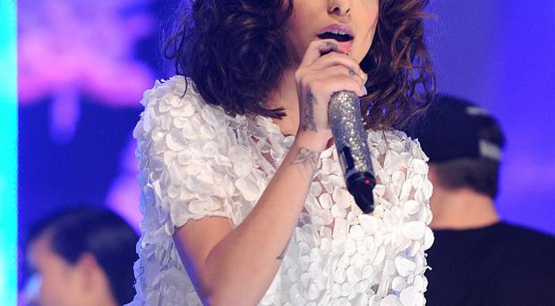 Cher Lloyd has apologised to Cheryl Cole