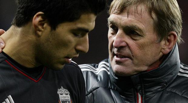 Liverpool manager Kenny Dalglish (right) backed Luis Suarez over allegations of racism against Manchester United's Patrice Evra