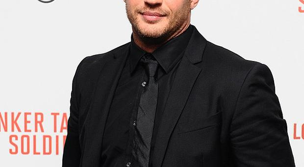 Tom Hardy plays the son of a recovering alcoholic in Warrior