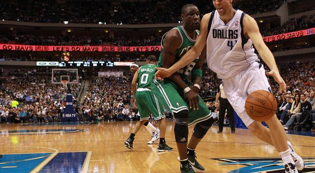 DALLAS, TX - FEBRUARY 20: Dirk Nowitzki #41 of the Dallas Mavericks dribbles the ball past Mickael Pietrus #28 of the Boston Celtics at American Airlines Center on February 20, 2012 in Dallas, Texas. NOTE TO USER: User expressly acknowledges and agrees that, by downloading and/or using this Photograph, user is consenting to the terms and conditions of the Getty Images License Agreement. (Photo by Ronald Martinez/Getty Images)