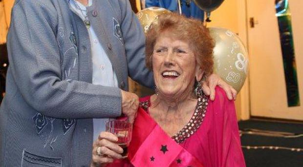 Granny Messie celebrating her 80th birthday with family and friends at The Linfield Supporters Club Shankill Road